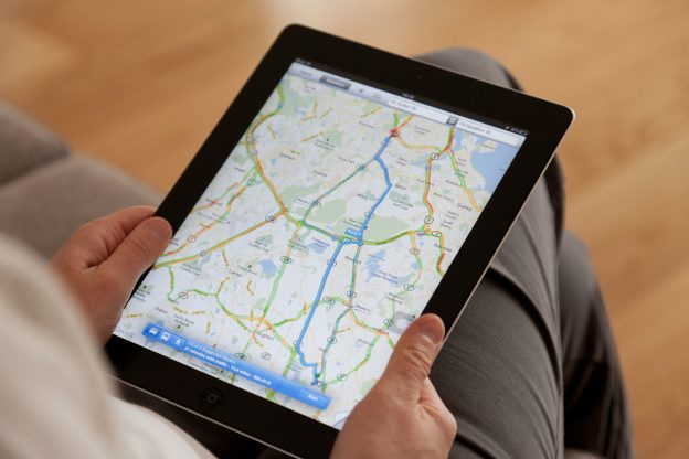 Tablet on the lap having the google Map on the screen